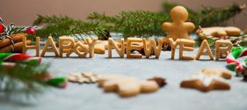 Caramelo del pan de jengibre de la tarjeta de felicitación del fondo del Año Nuevo de la Navidad Imágenes de archivo libres de regalías