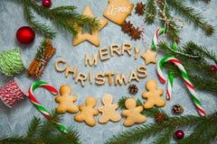 Caramelo del pan de jengibre de la tarjeta de felicitación del fondo del Año Nuevo de la Navidad Imagenes de archivo