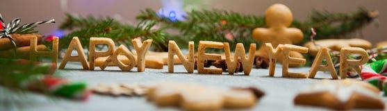 Caramelo del pan de jengibre de la tarjeta de felicitación del fondo del Año Nuevo de la Navidad Foto de archivo