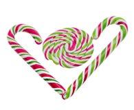 Caramelo dulce coloreado, palillo de la piruleta, dulces de San Nicolás, candys aislados, fondo blanco de la Navidad Imagen de archivo libre de regalías