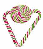 Caramelo dulce coloreado, palillo de la piruleta, dulces de San Nicolás, candys aislados, fondo blanco de la Navidad Fotografía de archivo