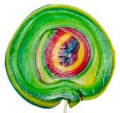 Caramelo dulce coloreado, palillo de la piruleta, dulces de San Nicolás, candys aislados, fondo blanco de la Navidad Fotos de archivo libres de regalías