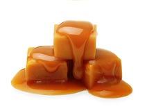 Caramelo e molho do caramelo isolados Imagem de Stock