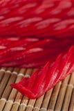 Caramelo rojo brillante del regaliz Fotografía de archivo