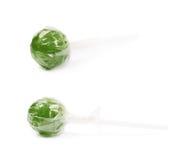 Caramelo verde de la piruleta aislado Foto de archivo libre de regalías