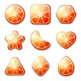Caramelos anaranjados para el juego del partido tres Imágenes de archivo libres de regalías