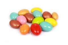 Caramelos coloridos aislados en blanco Fotografía de archivo libre de regalías