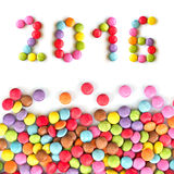 2016 caramelos coloridos aislados en blanco Imágenes de archivo libres de regalías