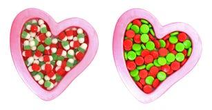 Caramelos coloridos en dimensiones de una variable del corazón Fotografía de archivo libre de regalías