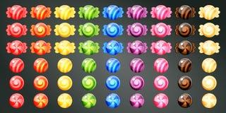 Caramelos coloridos envueltos Fotos de archivo