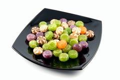 Caramelos de azúcar multicolores de los dulces Imagen de archivo