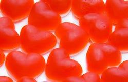 Caramelos de la fruta bajo la forma de corazón. Fotografía de archivo