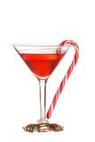 Caramelos de la Navidad con un martini rojo Fotografía de archivo libre de regalías