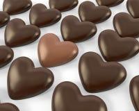 Caramelos en forma de corazón del chocolate con leche Fotos de archivo