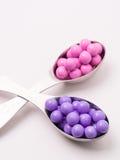 Caramelos rosados y púrpuras coloridos Imagen de archivo libre de regalías