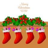 Caramelos y dulces de la Navidad en calcetines de la Navidad Fotos de archivo libres de regalías