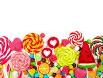Caramelos y piruletas coloridos Visión superior Imagenes de archivo