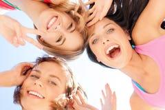 Caras das meninas com as máscaras que olham para baixo Imagem de Stock Royalty Free