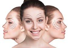 Caras de la mujer joven con las flechas de elevación Fotos de archivo libres de regalías