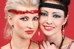 Caras de los dos modelos de manera Fotografía de archivo
