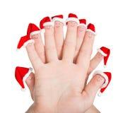 Caras de los fingeres en los sombreros de Papá Noel aislados en el fondo blanco Concep Imagen de archivo libre de regalías