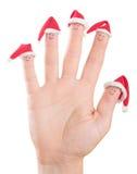 Caras de los fingeres en los sombreros de Papá Noel Familia feliz que celebra concepto Fotografía de archivo libre de regalías