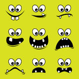 Caras de monstruos en un fondo verde imagen de archivo libre de regalías