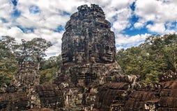 Caras de pedra antigas do templo de Bayon, Angkor, Camboja Fotos de Stock