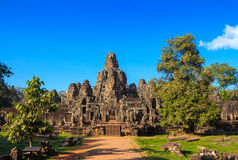 Caras de pedra antigas do templo de Bayon, Camboja imagens de stock royalty free