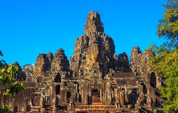 Caras de pedra antigas do templo de Bayon, Camboja foto de stock royalty free