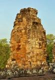 Caras de pedra gigantes no templo de Bayon em Camboja Foto de Stock