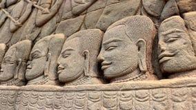 Caras de piedra de los guerreros del Khmer Foto de archivo libre de regalías