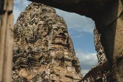 Caras de piedra esculpidas del Buda en el templo de Bayon Imagen de archivo libre de regalías