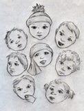 Caras del bebé Imagenes de archivo