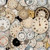 Caras del reloj que repiten el fondo Imagen de archivo libre de regalías