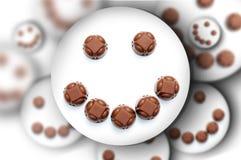 Caras del smiley de los chocolates Fotos de archivo libres de regalías