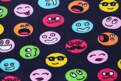 Caras divertidas de las materias textiles foto de archivo