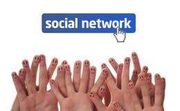 Caras felices del dedo como red social Foto de archivo