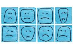 Caras infelices Foto de archivo libre de regalías