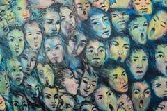 Caras no muro de Berlim Imagem de Stock