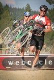 Caras sonrientes en la raza de Cyclocross Fotos de archivo libres de regalías