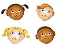 Caras tristes de niños Fotografía de archivo