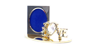 24 Carat gold plated picture holder. Gold plated picture holder with text love stock photography