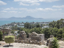 Caratagina and view on Tunis. Ruins of Cartagina - monument in Tunisia and part of Musem building. And Tunis panoramic photo stock photography