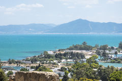Caratagina and view on Tunis. Ruins of Cartagina - monument in Tunisia and part of Musem building. And Tunis panoramic photo royalty free stock photography