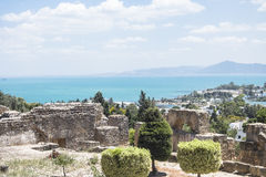 Caratagina and view on Tunis. Ruins of Cartagina - monument in Tunisia and part of Musem building. And Tunis panoramic photo royalty free stock image