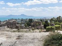 Caratagina and view on Tunis. Ruins of Cartagina - monument in Tunisia and part of Musem building. And Tunis panoramic photo stock image
