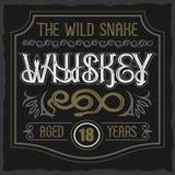 Carattere dell'annata di vettore Il distintivo selvaggio del whiskey del serpente Fotografia Stock Libera da Diritti