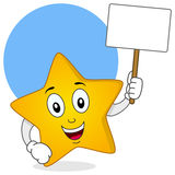 Carattere giallo della stella che tiene segno in bianco Fotografia Stock