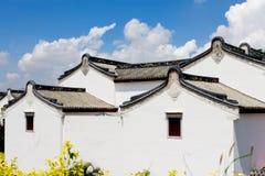 Caratteristiche nazionali cinesi delle costruzioni vernacolari dell'abitazione Fotografie Stock